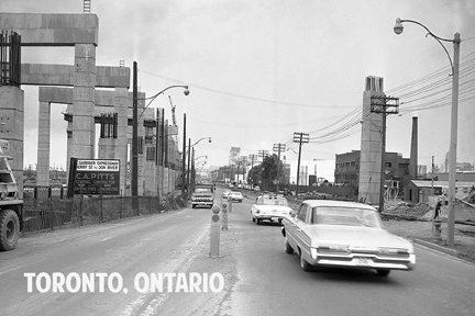 Lakeshore Boulevard East, looking West at Cherry Street, showing the construction of the Frederick G. Gardiner Expressway. Toronto, Ontario c1963.